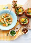 'Primavera' Chicken soup, served with baked asparagus egg nests