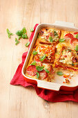 Sandwich lasagna with cheese, ham and tomatoes