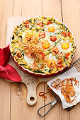 Spinach spaetzle casserole with eggs and fried onions