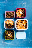 Oven-roasted chickpeas and cauliflower with garam masala in plastic boxes