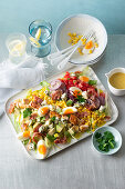 Cobb salad with eggs, bacon, chicken and blue cheese