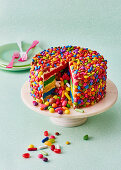 Colorful piñata cake with sweets
