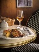 Confit de canard with potato gratin on a restaurant table
