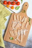 Homemade fresh pizzoccheri on a wooden board