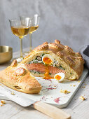 Russian kulebjak with salmon, rice and eggs
