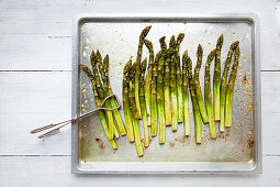 Roasted green asparagus on a baking tray