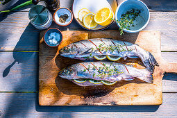 Fresh trout with lemon and herbs prepared for the grill