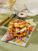 Crispy corn waffles with tomatoes, red onions and yoghurt