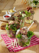 Four kinds of meatballs in a jar