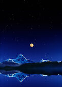 The holy Macchapucchare mountain under full moon and starry sky, Pokhara, Nepal, Asia