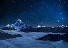 Night sky over snowcapped mountains, Pokhara, Kaski, Macchapucchare, Annapurna, Nepal, Asia