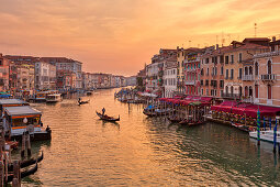 Grand Canal with gondola at sunset from Rialto Bridge in Venice, Veneto, Italy