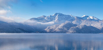 View over the Kochelsee to Herzogstand and Heimgarten on a cold winter morning, Kochel am See, Bavaria, Germany, Europe
