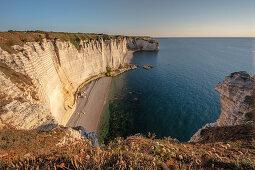 Chalk cliffs cliff at the golden hour near Étretat, Normandy, France.