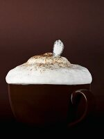 Cup of cappuccino with milk foam and spoon