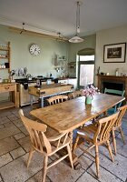 Kitchen with wooden furniture and stone floor