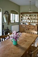 Wooden dining table and dresser in kitchen