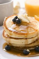 Pancakes with butter and blueberries for breakfast