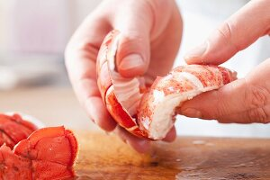 Removing lobster meat from the shell