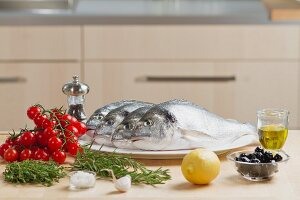 Fresh seabream with herbs and cherry tomatoes
