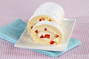 Sponge Swiss roll with a strawberry and cream filling