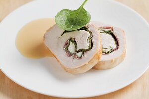 Turkey roulade filled with spinach and feta cheese