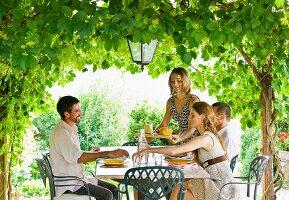 Group enjoying meal in garden