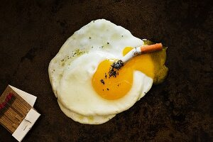 Cigarette in a Fried Egg; Matches