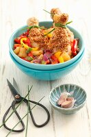 Chicken legs with sesame seeds, peppers and pineapple
