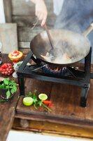 Food being fried in a wok