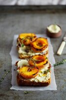 Slices of toast topped with roasted peaches and vanilla mascarpone cream