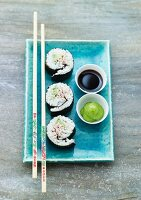 Maki sushi with soy sauce and wasabi paste