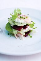 An apple millefeuille with beetroot and smoked trout
