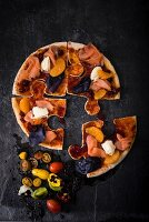 A pizza puzzle with smoked salmon and cranberry sauce