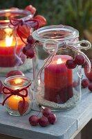 Alte Einmachgläser als Windlichter mit aus Kerzenresten selbstgemachten