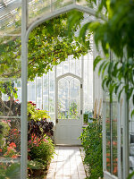 Arundel Castle GARDENS, West Sussex: THE Collector Earls Garden; THE INTERIOR of THE Greenhouse - VIEW THROUGH THE DOOR TO THE DOOR BEYOND - Framing