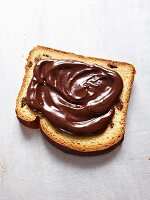 A slice of cake spread with nutella