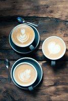 Latte art in cappuccinos