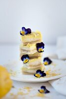 Stacked lemon slices decorated with horned violets