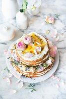 Victoria sponge-style citrus cake with lemon curd and mango