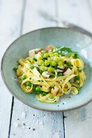 Ribbon noodles with smoked tofu and peas