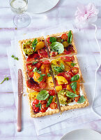 Vegetable tart with pepper, tomatoes and basil