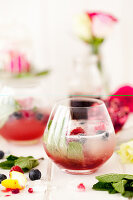 Grenadine topped with sparkling cloudy lemonade with mint and raspberries