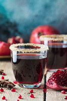 Healthy Pomegranate juice with fresh pomegranate fruits