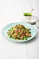 Couscous mit Gyros vom Schwein, Erbsen und Spinat