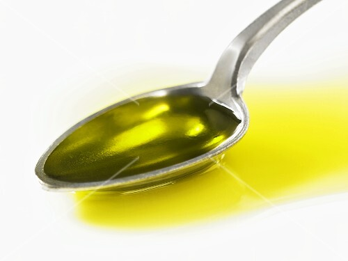 A spoonful of olive oil (close-up)