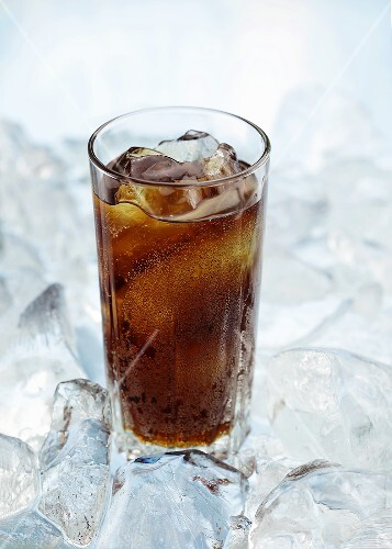 A glass of cola on ice