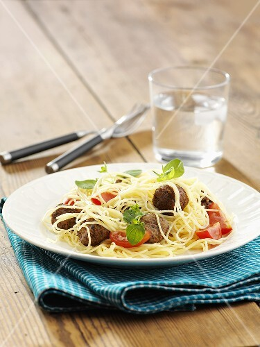 Spaghetti with meat balls and tomatoes