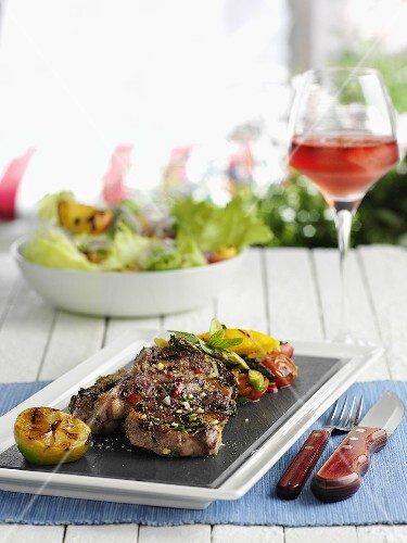 Entrecote and grilled vegetables, salad and rose wine
