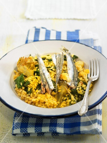 Rice with sardines, spinach, artichokes and cauliflower (Spain)